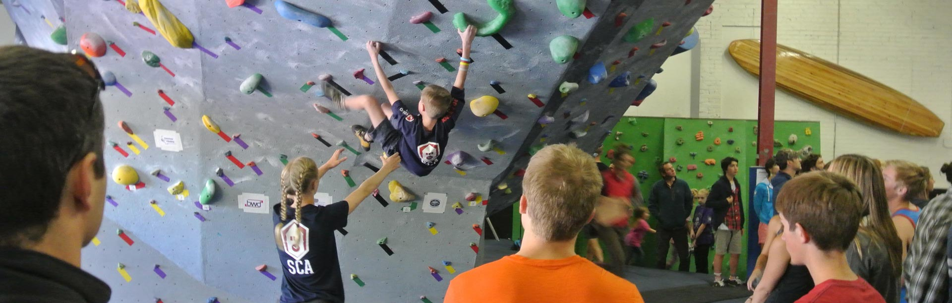 Freestone Climing Center - indoor climbing gym - photo of a climber spotting another climber.